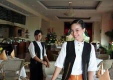 Empregada de mesa dois no trabalho Fotografia de Stock