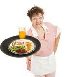 Empregada de mesa - o jantar é serido Fotos de Stock Royalty Free