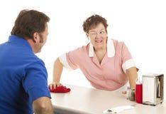 Empregada de mesa - piscadela e um sorriso Imagens de Stock