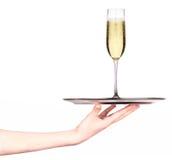 Empregada de mesa que guarda a bandeja com vidro do champanhe Imagem de Stock Royalty Free
