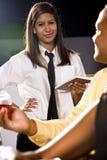 Empregada de mesa que toma o pedido de um cliente Foto de Stock Royalty Free