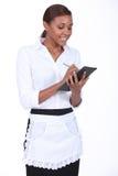 Empregada de mesa que toma um pedido Foto de Stock