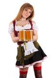 Empregada de mesa 'sexy' Oktoberfest com cerveja Fotografia de Stock Royalty Free