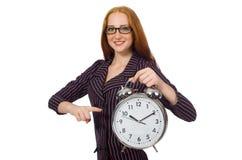 Empregado de escritório bonito com o despertador isolado no branco Fotos de Stock Royalty Free