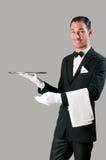 Empregado de mesa feliz com bandeja Imagem de Stock