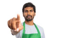 Empregado indiano que indica a câmera fotografia de stock