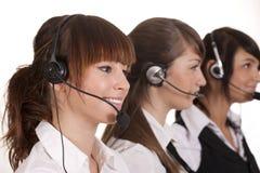 Empregados do centro de chamadas com auriculares Imagem de Stock Royalty Free