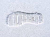 Empreinte de pas dans la neige Photographie stock libre de droits