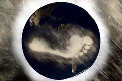 Empreinte de pas de carbone sur la planète Photos stock