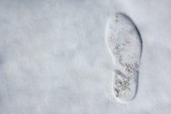 Empreinte de pas sur la neige image stock