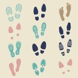 Empreintes de pas colorées - femelle, mâle et chaussure de sport illustration stock