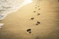 Empreintes de pas dans le sable Photos stock