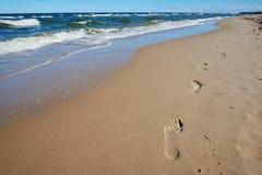 Empreintes de pas en sable Images stock