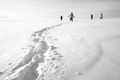 Empreintes de pas sur la neige Photographie stock libre de droits
