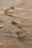 Empreintes de pas sur la plage Photos stock