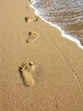 Empreintes de pas sur le sable Images stock