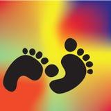 Empreintes de pas sur le tapis Image stock