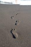 Empreintes de pas vers la mer Images libres de droits