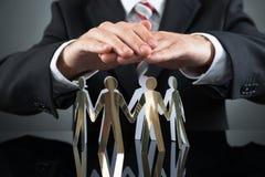 Empresário Protecting Cutout Figures Foto de Stock Royalty Free