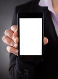 Empresário que mostra o telefone celular imagem de stock