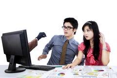 Empresários chocados que olham o hacker 2 Fotos de Stock Royalty Free