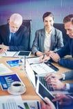 Empresários na sala de conferências imagem de stock royalty free