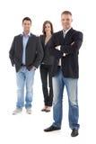 Empresários ocasionais que levantam no estúdio Foto de Stock