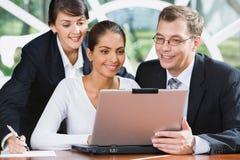 Empresários ocupados Imagem de Stock