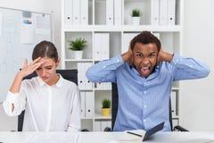 Empresários para fora forçados Fotografia de Stock