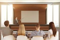 Empresários que olham a apresentação Foto de Stock