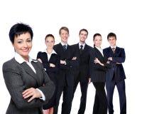 Empresaria acertada con grupo de trabajo. Imagenes de archivo