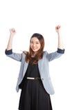 Empresaria acertada joven que celebra éxito Fotografía de archivo libre de regalías