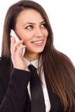 Empresaria acertada sonriente feliz con el teléfono celular fotografía de archivo libre de regalías