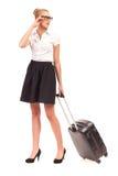 Empresaria alegre con la maleta. Foto de archivo