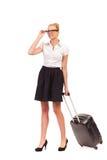 Empresaria alegre con la maleta. Foto de archivo libre de regalías