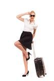 Empresaria alegre con la maleta. Imagen de archivo