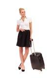 Empresaria alegre que espera con la maleta. Imagen de archivo libre de regalías