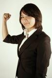 Empresaria asiática acertada imagenes de archivo