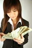 Empresaria asiática con el dinero Imagenes de archivo