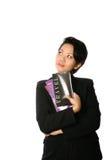 Empresaria asiática con un puñado de broch del recorrido Foto de archivo