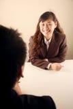Empresaria asiática en una reunión Imagen de archivo libre de regalías