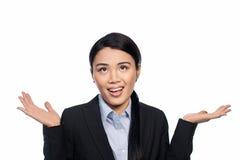 Empresaria asiática que encoge sus hombros Foto de archivo libre de regalías