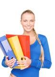 Empresaria atractiva joven con las carpetas Fotografía de archivo libre de regalías