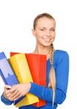 Empresaria atractiva joven con las carpetas Imagen de archivo libre de regalías