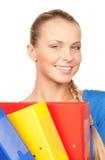 Empresaria atractiva joven con las carpetas Fotos de archivo