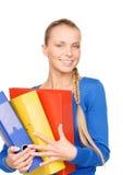 Empresaria atractiva joven con las carpetas Fotografía de archivo
