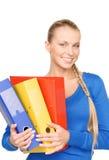 Empresaria atractiva joven con las carpetas Foto de archivo libre de regalías