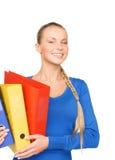 Empresaria atractiva joven con las carpetas Imagen de archivo