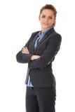 Empresaria atractiva joven con los brazos cruzados Fotografía de archivo libre de regalías
