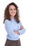 Empresaria bastante joven aislada en el azul que mira de lado Fotos de archivo libres de regalías